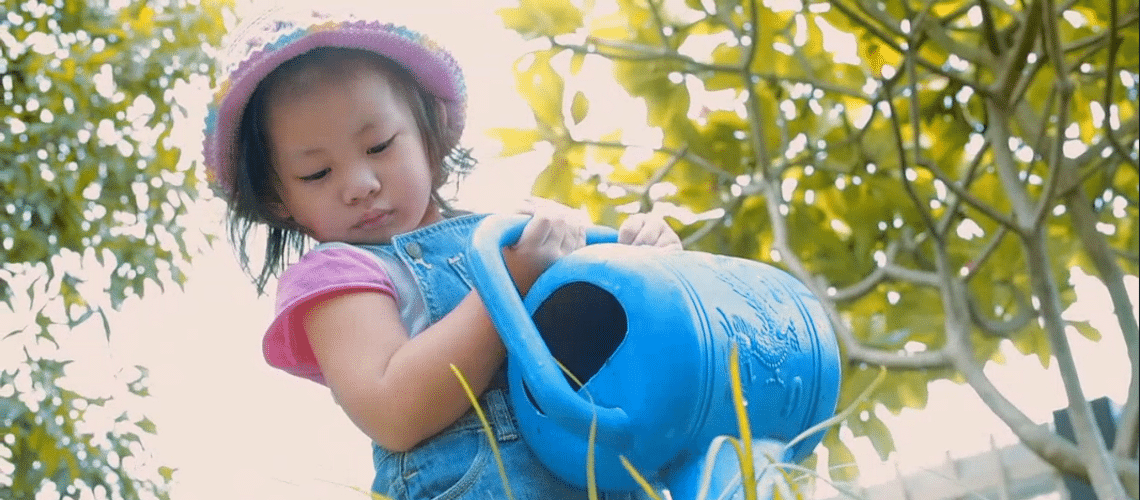 Connect Preschool - preschool child with a watering can