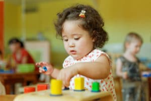 small child concentrating on puzzles